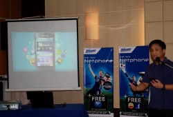 Edmon Joson, Smart Communications Inc. product development manager, demonstrates features of the Netphone 701 during a press conference in Cebu. (CLICK TO ENLARGE)